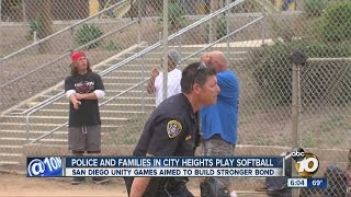 police and families in city heights play softball