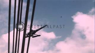 Lieutenant Tracy boards a Sikorsky S-51 US Navy helicopter (HO3S-1A) on the deck ...HD Stock Footage