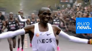 Kenyan Eliud Kipchoge becomes the first person to run unofficial, sub-two-hour marathon