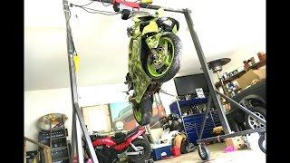 Homemade hoist lifting a motorcycle