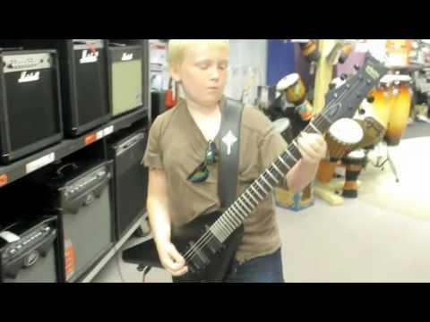 10 year old boy shreds electric guitar