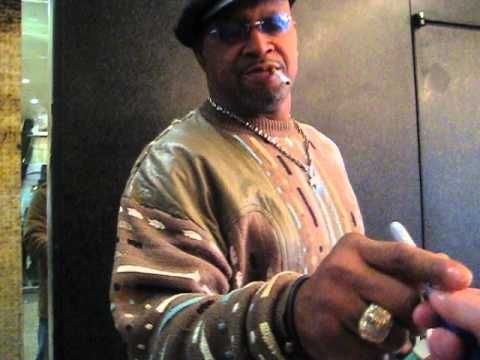 Mike Rozier signs autographs for The SI KING  12-14-14