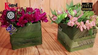 Arranjo de flores com alstroemerias e folhas de ruscus e de estrelitzia