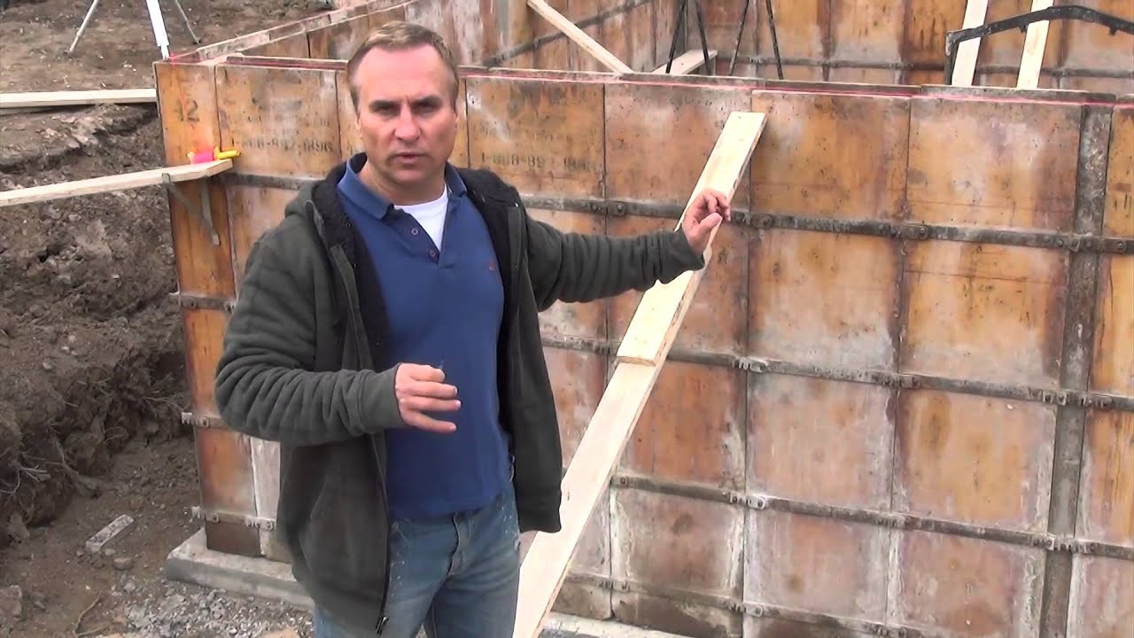 How to build a house forming the concrete walls ep 22 for Basement wall forms