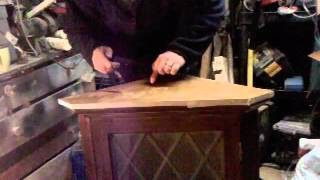 Hand Veneering The Top Of A Corner Cabinet