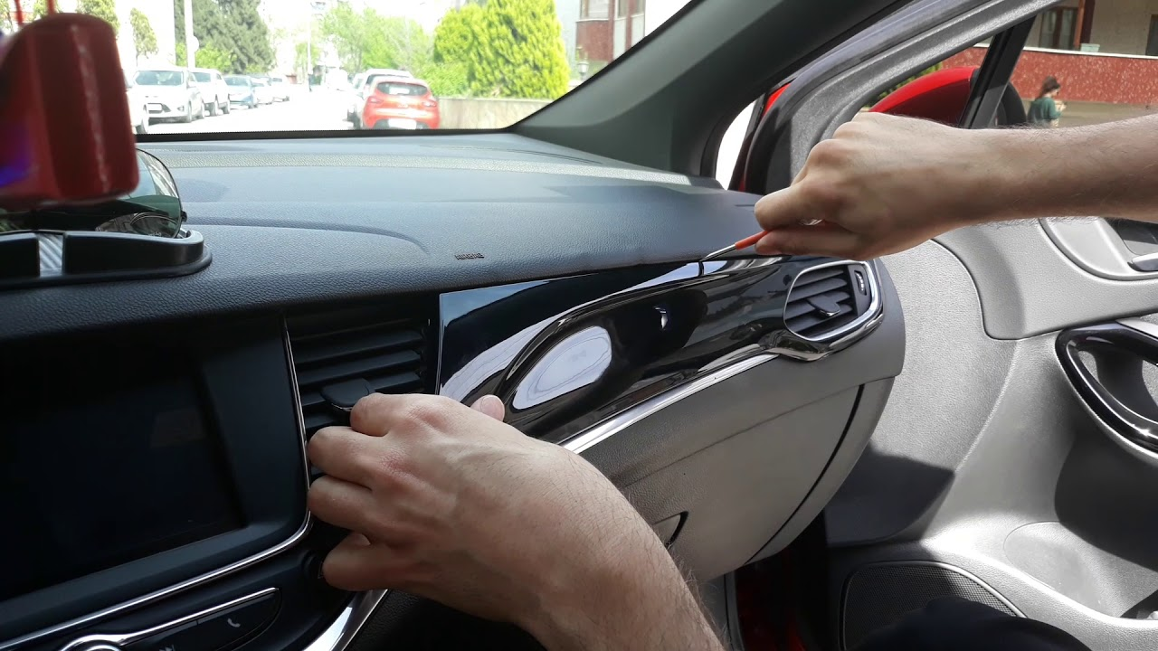 How to remove piano black trim and dash panel : - Vauxhall