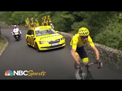 Chris Froome recovers from Stage 15 flat tire