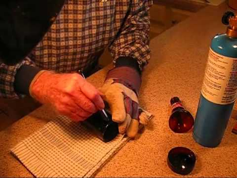 Beer and wine bottles into glass shards for making beads