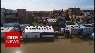 Refugee homes under water - BBC News