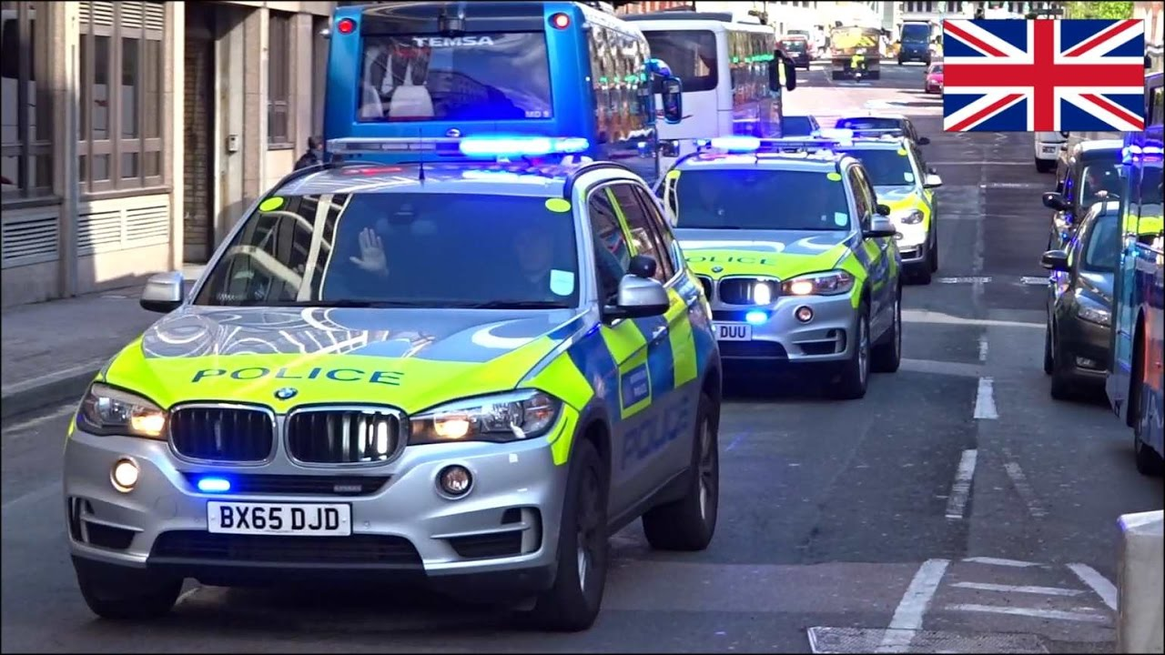 Convoy Of Three Armed Police Cars Responding With Siren