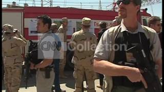 Blackwater contractors being guarded by men with guns. to license this clip, click here: http://collection.cnn.com/content/clip/370015_168.do