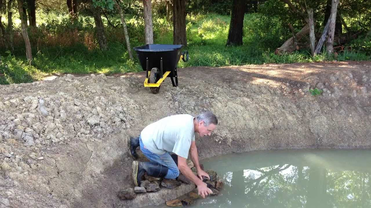 Filling the fishing pond expansion almost youtube for Filling in a pond