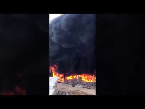 Huge fire at Global Indian Int School Construction in Punggol; 2 workers trapped on gondola.