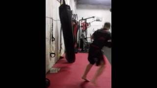 Master Dillon finishing off his work out on the heavy bag.