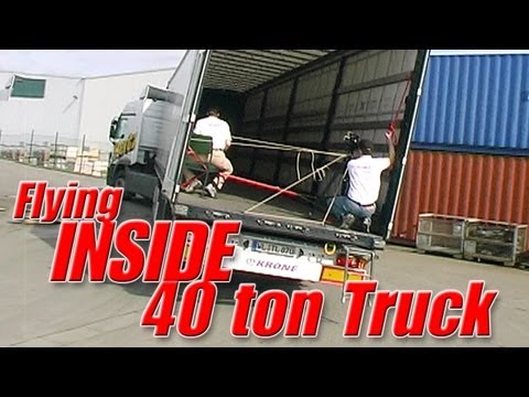 Flying heli INSIDE a moving 40 ton truck - what happens?!