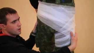 Фіксація пов'язки в тазовій частині та накладання марлевої пов'язки при травмі руки