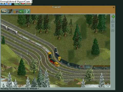 Chris Sawyer Locomotion - With an iron ore train to Pueblo Steelplant |