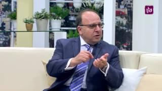 د. غسان سعيد ود. دلال العبداللات - المؤتمر العالمي الثلاثين للجمعية الطبية الوطنية العربية الأميركية