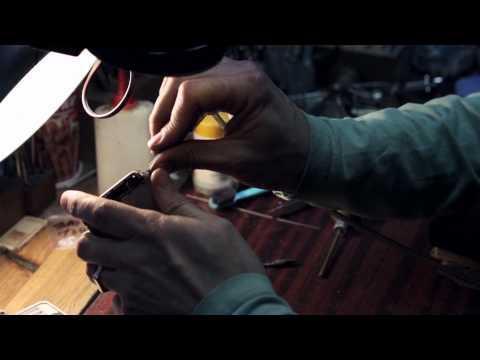 Jewelery handcraft and stones inserting into luxury 24k gold iPhone 5S   Rarus Exclusive