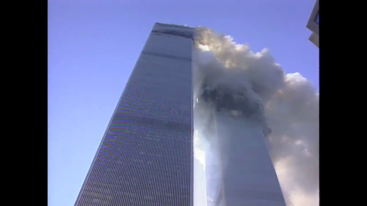 N J  Burkett reporting as Twin Towers begin to collapse on September 11,  2001