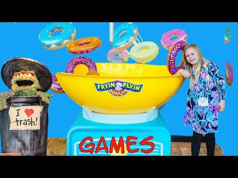 Assistant Plays Toy Fair Games with Tic Toc Tongues and Pie in the Face