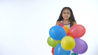 Young adorable kid playing with colorful balloons in trendy casual wear - playtime
