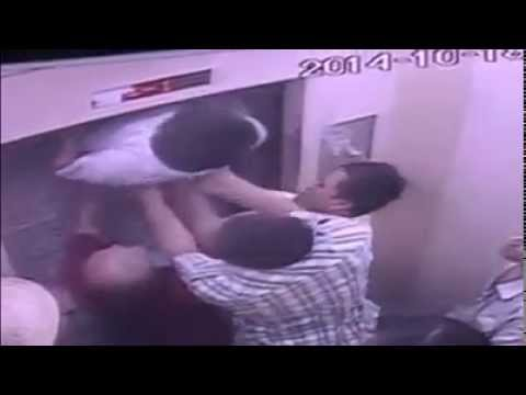 Chinese man almost cut in half by the lift he stuck in