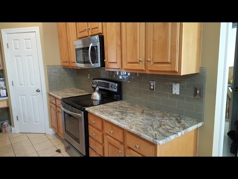 white kitchen cabinets design wall hanging ideas typhoon bordeaux granite countertops - youtube