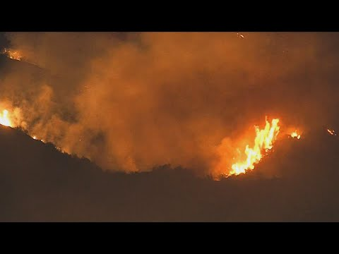 High winds threaten to further fan U.S. wildfires