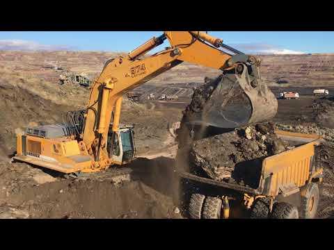 Liebherr 974 Excavator Loading Cat 777 Dumper