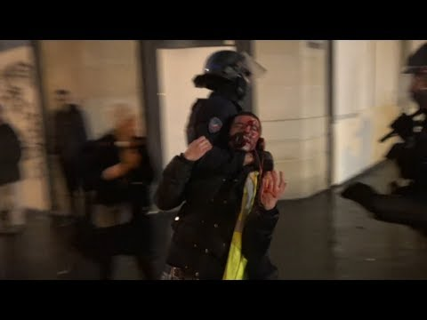 Police arrest people as looters raid shops in Paris