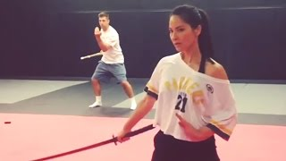 Aaron Rodgers Sword Fighting with Olivia Munn