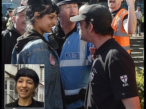 Defiant Asian woman who squared up to EDL leader after 25 men surrounded a Muslim woman.