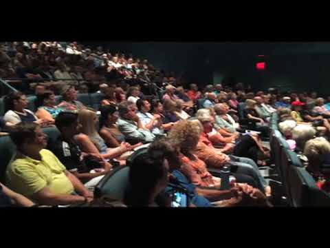 Erin Brockovich speaks to a crowd of over 300 people during a GenX Forum at UNCW's Lumina Theater