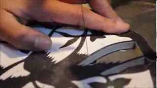 Cutting out a bird pattern.