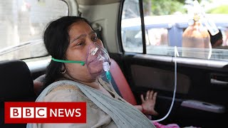 India 'shaken by Covid storm' - BBC News