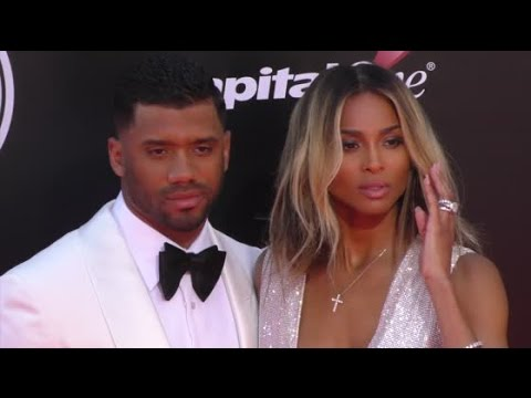 Newlyweds RUSSELL WILSON and CIARA show off her big wedding ring