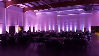 Duluth Armory with pink wedding lighting by Duluth Event Lighting.