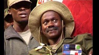 Teacher Mpamire's First Time to Act Ugandan President Museveni.(2003)