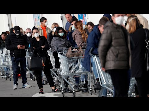 Coronavirus: Long queues form at supermarkets as Italy is put into lockdown