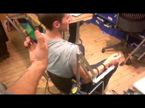 Testing Assistive Arm Exoskeleton with NMES