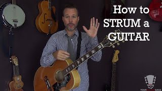 How to Strum a Guitar Correctly - Beginner Lesson