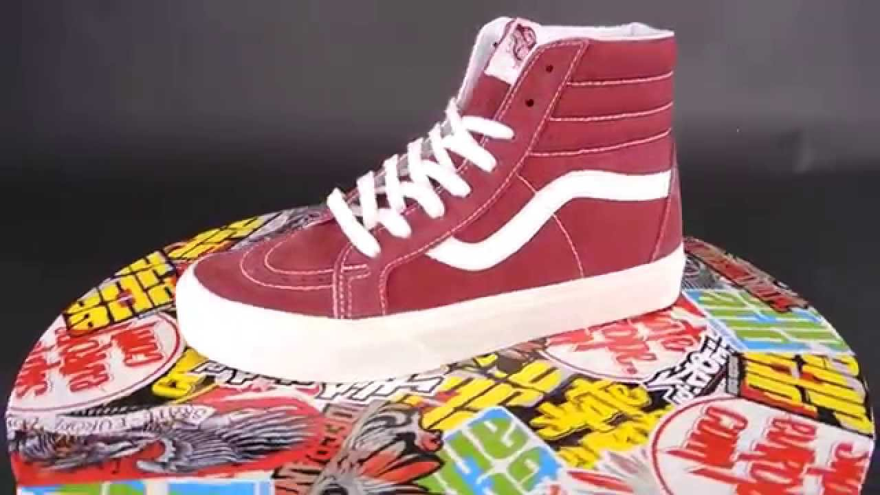 red and white high top vans on feet