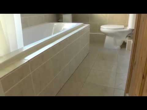 DIY Project: Tiled Bath Panel - 7 years later! - YouTube