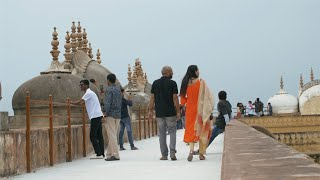 Back view shot of Indian couple walking around the Nahargarh Fort in Jaipur