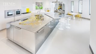 Polished Stainless Steel Kitchen In This House With Large Stainless Steel Island & White Cabinets