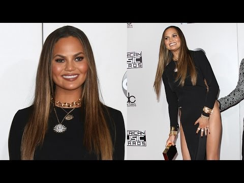 Chrissy Teigen Handles AMA Wardrobe Malfunction In The Best Way Possible