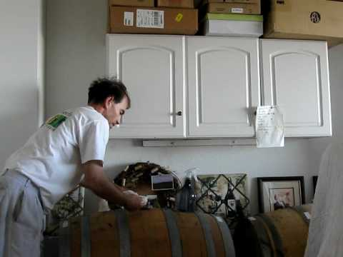 Topping Up The Oak Wine Barrel