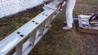 Tying two extension ladders together