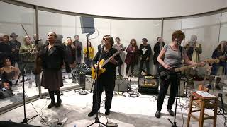 The Raincoats perform in Dan Graham's Stage Set for Music